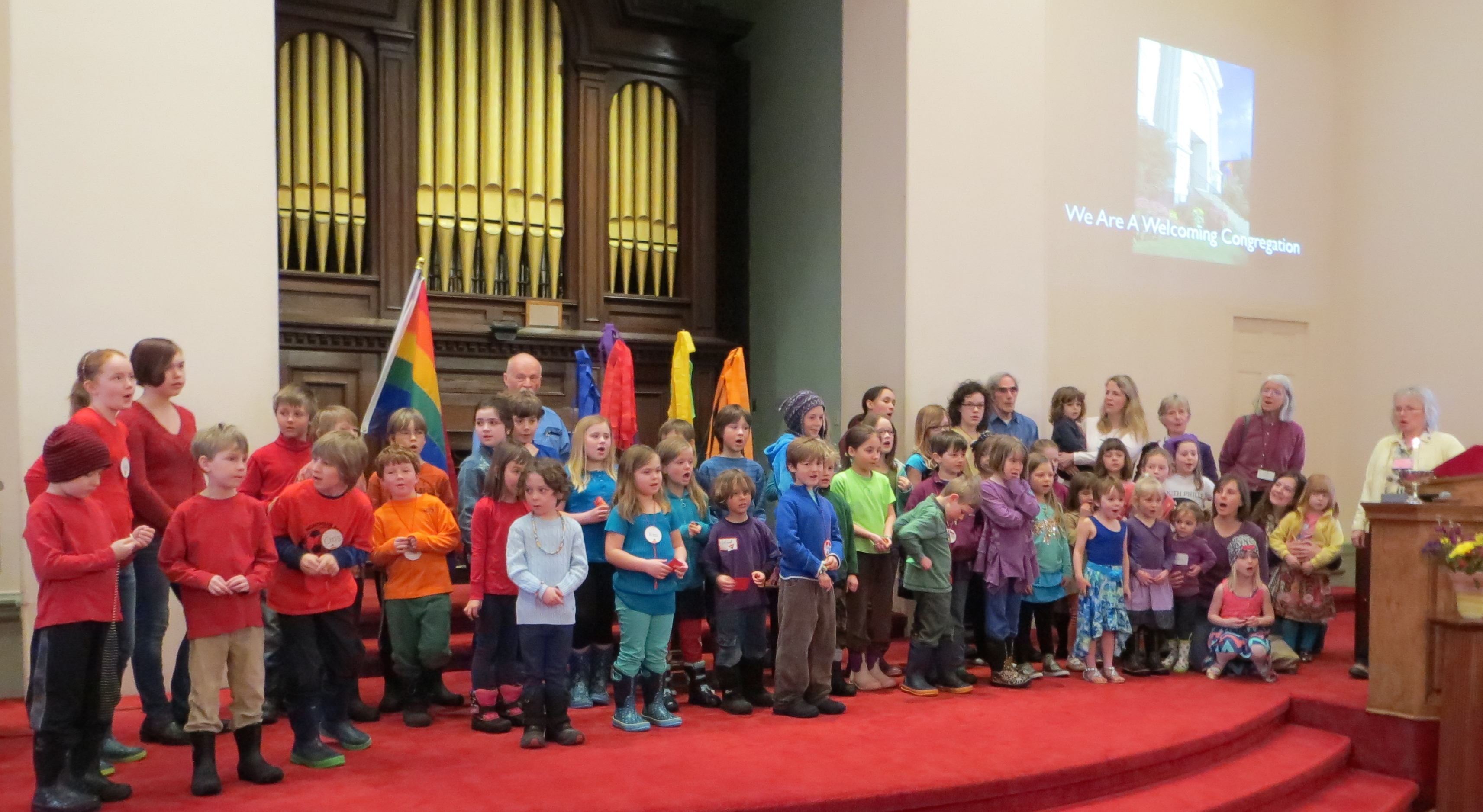 The church children dressed in rainbow colors as part of the 2014 celebration of the LGBTQ community: Photo by Dave Armstrong